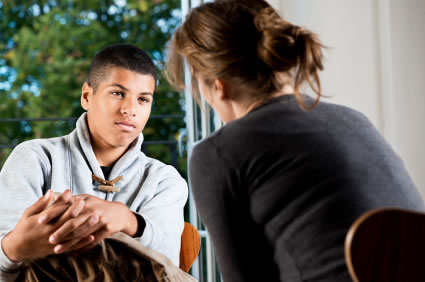 young man talking to counselor